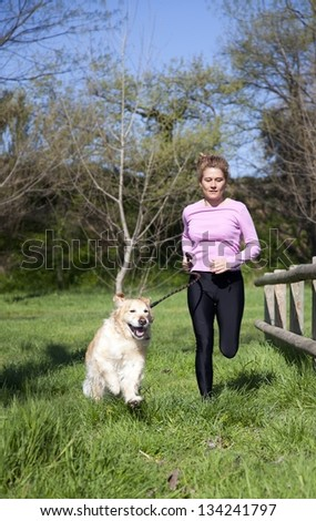 Girl running through the woods with your dog