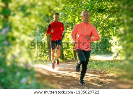 girl runs in the Park #1135029722