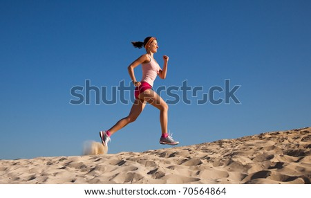 girl runs on sand - stock photo