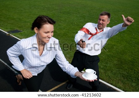 girl runs with a white cup stadium
