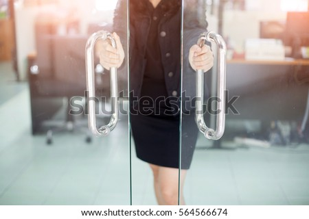 Girl's hand open the door with glass reflection background #564566674