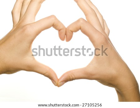 girl's hands forming a heart