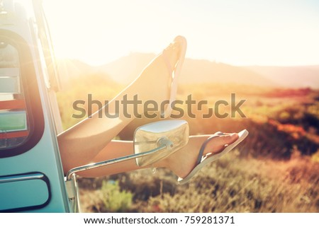 girl's legs in a retro car  at...
