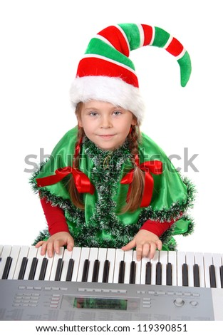 Girl - Santa's elf plays a synthesizer. Isolated on a white