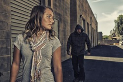 GIRL SELF DEFENSE   A young woman sees a suspicious person walking behind her and plans to defend herself against a male attacker in an alley. Refuse to be a victim.