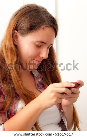 Girl Sending a Text Message on Her Phone