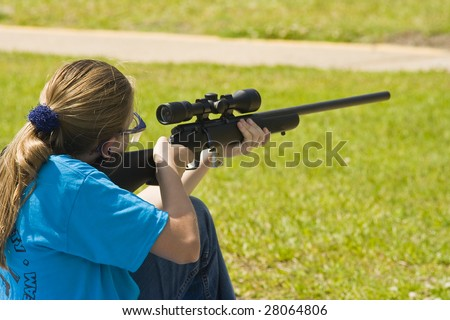 Girl shooting 22 rifle at shooting sports
