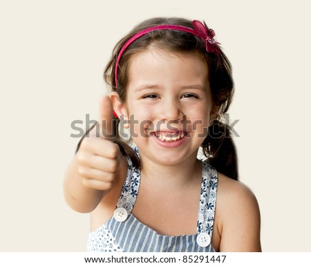 Girl showing her thumb up - stock photo