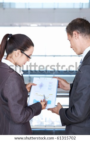Girl shows a colleague sales chart