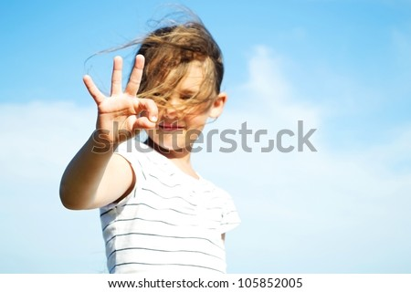girl shows a hand sign