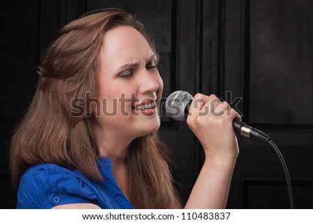 Girl Singing in Studio