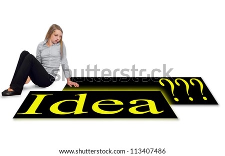Girl sitting and  staring sad at the posters  looking for new idea