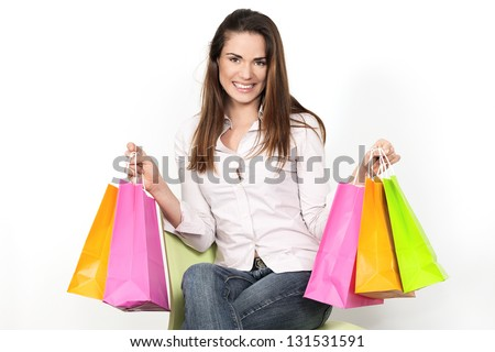 girl sitting in a chair with shopping bags