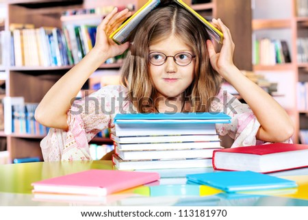 Girl sitting in a library