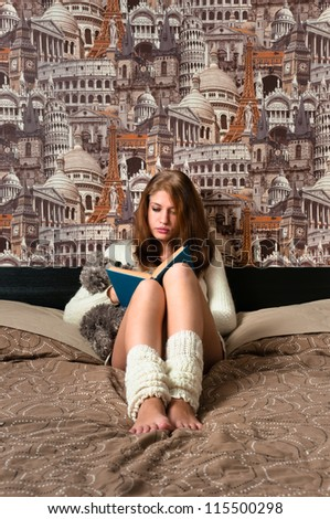 Girl sitting in bedroom and reading with city art on background is like imagination - stock photo
