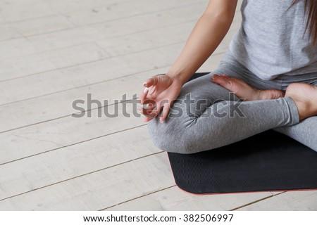 Girl sitting in the lotus position. Padmasana #382506997