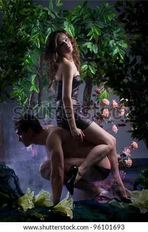 girl sitting on the back of a young man among the flowers and trees blanketed in smoke