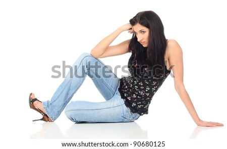 Girl sitting on the floor at white background