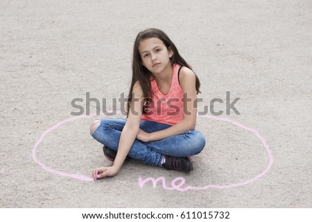 Girl sitting on the ground and drawing personal space. Selective focus Сток-фото ©