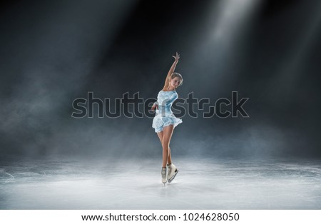 girl skating at ice arena