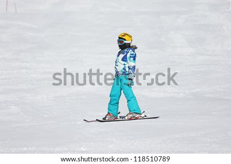 Girl ski on the snow