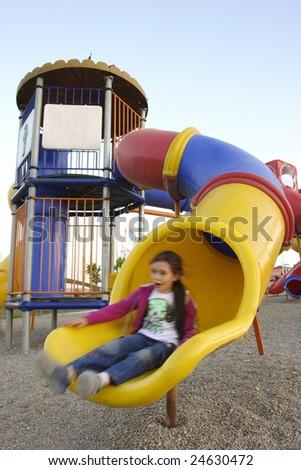 Girl slides in playground