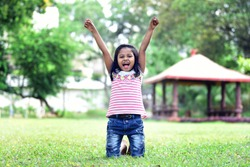 girl smiling and screaming for success, Celebration concept, Kids freedom, fun and happiness for kid