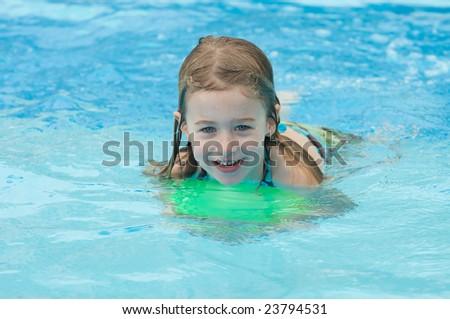 Girl smiling in swimming pool