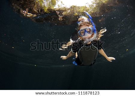 Girl snorkelling - stock photo