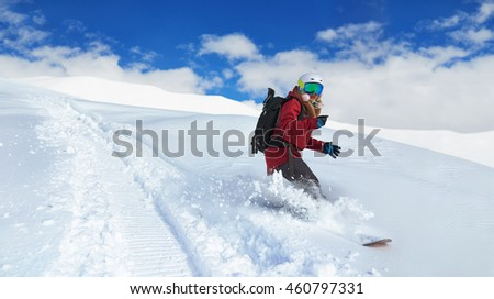 girl snowboarder rides fast on loose snow Freeride #460797331