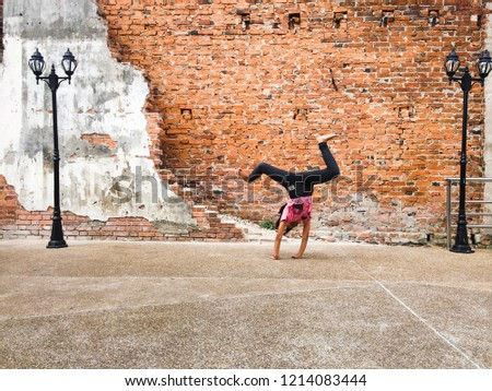 Girl somersault on street #1214083444