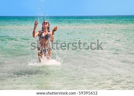 Girl splashing water in the sea