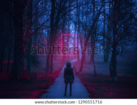 Girl stand on the scary road in the paranormal world. Neon portal. Retro style. Retrowave. Strange forest in a fog with red leaves. Mystical atmosphere. Dark mysterious park.