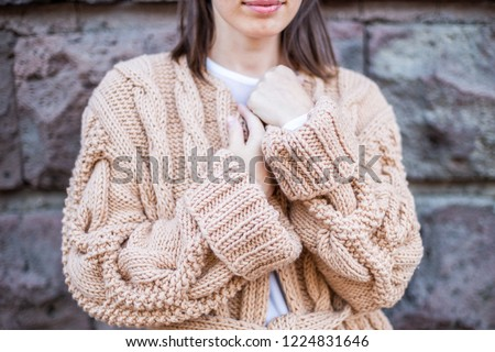 Girl standing in a handmade cardigan
