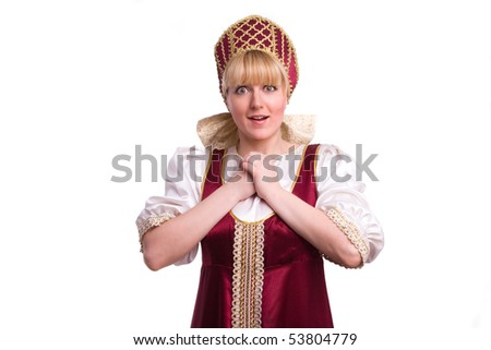 Girl standing in Russian traditional costume. Woman is wearing sarafan and kokoshnik . The girl in red old russian dress. Isolated on white.