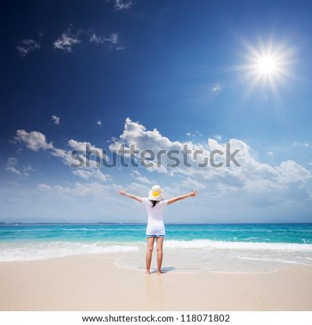 girl standing on beach