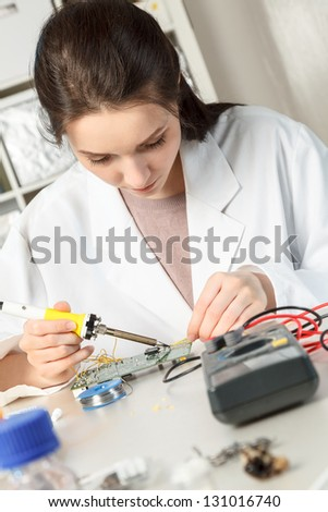 Girl student in the laboratory of electronics university
