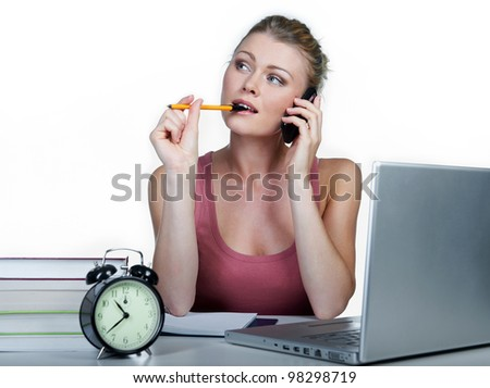 Girl student. Sits at a desktop with the computer.