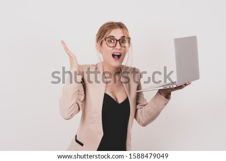 Girl stunned expression and touch her head. Unbelievable news. Surfing internet laptop. Toned