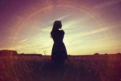 girl sunset field sun glare