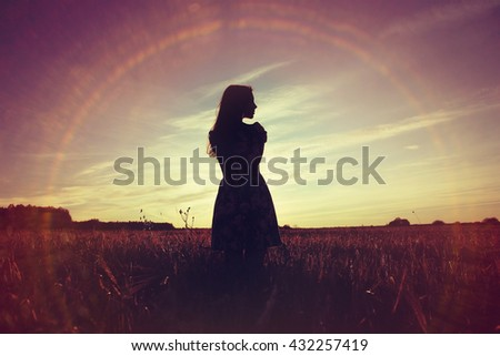 girl sunset field sun glare