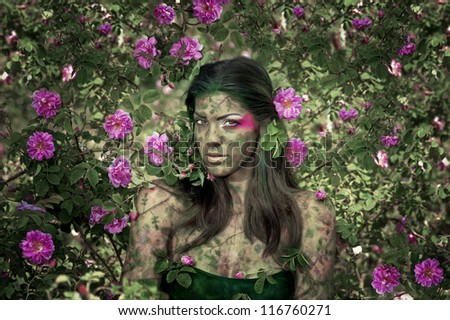 Girl surrounded by a rose leafs