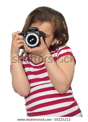 Girl taking a picture with a professional camera isolated on white