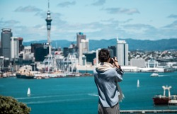 Girl taking photo in front of Auckland