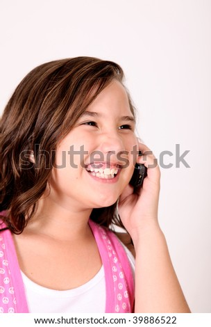Girl talking on her mobile phone and smiling.