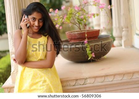 girl talking on mobile phone - stock photo