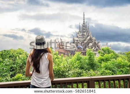 Girl tan destination to sanctuary of truth, pattaya,thailand #582651841