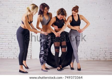girl teaches Yoga young in the Studio woman #749373364