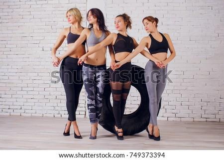 girl teaches Yoga young in the Studio woman #749373394