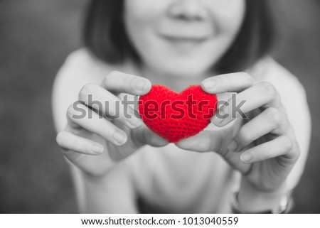 Girl Teen with Love and Hearts hold in her hands in valentine's day art photography #1013040559